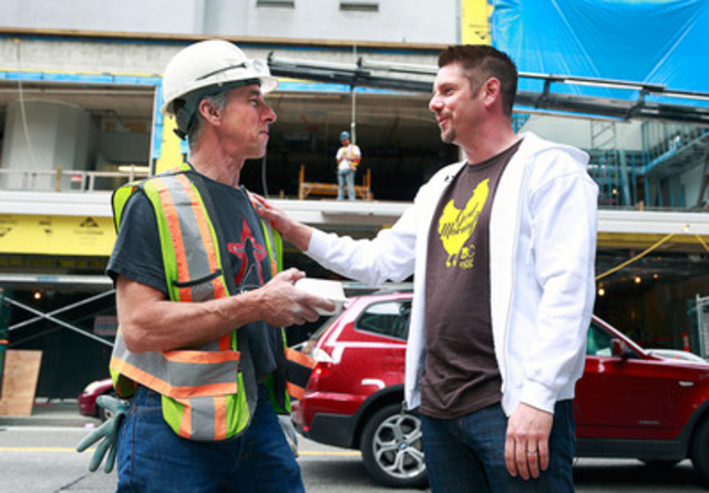 BC Egg Farmers representative Dan Kampen (right), delivers a hot breakfast to early rising construction worker, Dean Harris (left) as a thank-you for his hard work. Egg farmers rewarded more than 300 people across multiple work sectors around Greater Vancouver this morning as part of the Good Morning BC program, an initiative that recognizes the behind-the-scenes 'unsung heroes' that help the city operate. (CNW Group/BC Egg Marketing Board)