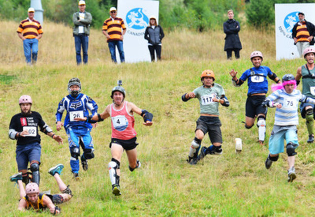 Ambitious cheese lovers tumble down the hill after glory and an 11-lb wheel of Boerenkaas cheese at the Canadian Cheese Rolling Festival in Whistler, British Columbia on August 15th, 2015. (CNW Group/Dairy Farmers of Canada (DFC))