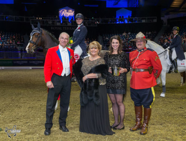 Megan Lane and Caravella are presented with the Butternut Ridge Trophy by Deborah Kinzinger Miculinic (second from left). Photo by Ben Radvanyi Photography (CNW Group/Royal Agricultural Winter Fair)