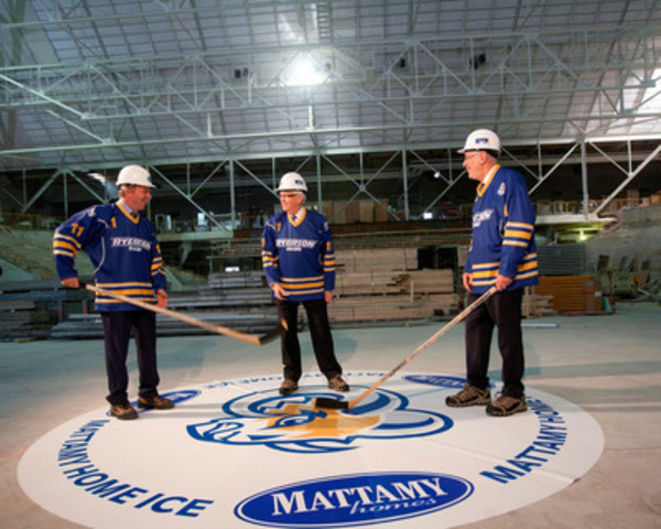 Peter Gilgan, Founder and CEO of Mattamy Homes (left), and Sheldon Levy, President of Ryerson University (right), wait for John Carmichael, MP for Don Valley West, to drop the puck for the first face-off inside the Peter Gilgan Athletic Centre at the Gardens. (CNW Group/Ryerson University)