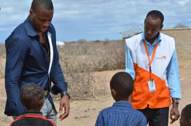 Kardinal Offishall (left) visited the Horn of Africa with World Vision staff, to witness the effect of the drought on children. (CNW Group/World Vision Canada)