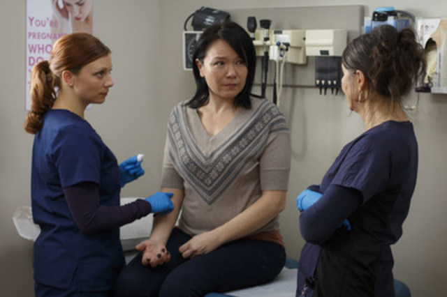Melanie played by Melissa-Jane Shaw attending to a patient in TVO's Hard Rock Medical, credit Michael Tien. (CNW Group/TVO)