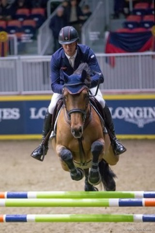 Harrie Smolders of The Netherlands raced to victory in the $20,000 Canine-Equine Challenge riding Apollonia 23 at the CSI4*-W Royal Horse Show on Saturday, November 12, in Toronto, ON. Photo by Mackenzie Clark (CNW Group/Royal Agricultural Winter Fair)