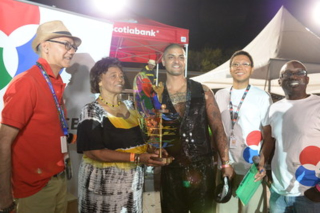 (L-R) Vishnu Ramcharan, Dr. Rita Cox, Innovation in Mas' Award recipient Shane Reid Mungal, Walter Stoddard and Francis Jeffers at the Scotiabank Caribbean Carnival Toronto King and Queen Competition and Show. (Photo credit: Anthony Berot) (CNW Group/Ontario Science Centre)