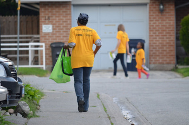 At the first *Brighter Nights* event for 2013, volunteers spread out through the Grace Hartman and Wilcox Creek Co-op. The Brighter Nights program responds to safety concerns in vulnerable neighbourhoods and helps make them brighter and safer, by installing compact fluorescent light bulbs (CFLs) and encouraging residents to leave them on overnight. (CNW Group/Toronto Hydro Corporation)