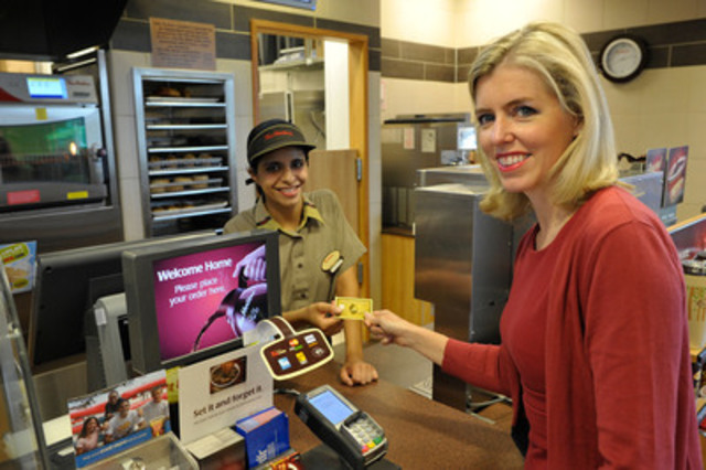 Jennifer Hawkins, Vice President of Merchant Services at American Express Canada pays for her double double using her American Express Card, which is now accepted at most Tim Hortons locations across Canada. (CNW Group/American Express)