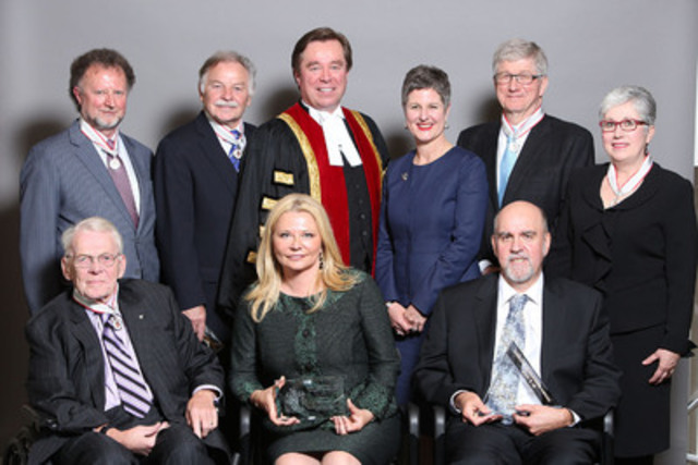 Law Society Treasurer Thomas G. Conway congratulates the 2014 award recipients yesterday. Front, L to R: Clare E. Lewis, OOnt., QC, Paula Stamp and Nigel G. Gilby. Back, L to R: Frank E.P. Bowman, William M. Trudell, Treasurer Conway, Susan E. Opler, W. A. Derry Millar, and Sandra R. Stephenson (CNW Group/The Law Society of Upper Canada)