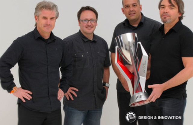 Denys Lapointe, executive vice-president of BRP's Design & Innovation team and the designers Ivan Brousseau, Steve Tétreault and André Côté, holding the First place F1 trophy of the Grand Prix du Canada. (CNW Group/BRP)