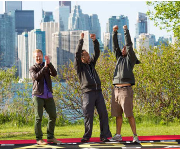 (L-R): Host Jon Montgomery with Tim Sr. and Tim Jr. winners of the first ever THE AMAZING RACE CANADA (CNW Group/CTV)