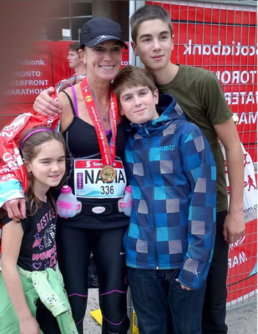 Nadia Bender, a fitness instructor and heart attack survivor, with her children after completing a marathon. Rehab was such a key part of Nadia's recovery that she's now also become certified in cardiac rehabilitation so she can help others. (CNW Group/Heart and Stroke Foundation)