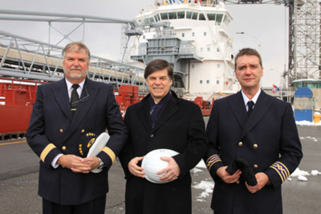 From left to right - Captain Jim Leaney, Terence Bowles (CEO of St. Lawrence Seaway Management Corporation) and Chief Engineer Jean-Louis Girard in front of the Baie St. Paul, the first ship to open the St. Lawrence Seaway. (CNW Group/The St. Lawrence Seaway Management Corporation)