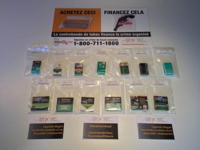 Treize paquets de cigarettes mentholées illégales présentement disponibles et/ou produites à Kahnawake, QC. (Groupe CNW/Coalition nationale contre le tabac de contrebande (CNCTC))