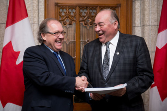 Minister of Aboriginal Affairs and Northern Development, Bernard Valcourt, and Northwest Territories Premier, Bob McLeod, together in the Foyer of the House of Commons after the introduction of Bill C-15, the Northwest Territories Devolution Act. (CNW Group/Government of Canada) (CNW Group/Aboriginal Affairs and Northern Development Canada)