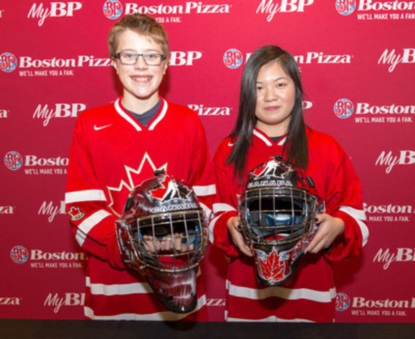 Boston Pizza and Bauer Design-A-Mask contest-winners Aiden Scott Rose of Langford, BC and Jessica Tran of Calgary, AB show off their winning designs in Toronto on December 14, 2015. The masks will be worn by Canada's National Junior Team goaltenders at the 2016 IIHF World Junior Championship. (CNW Group/Boston Pizza International Inc.)