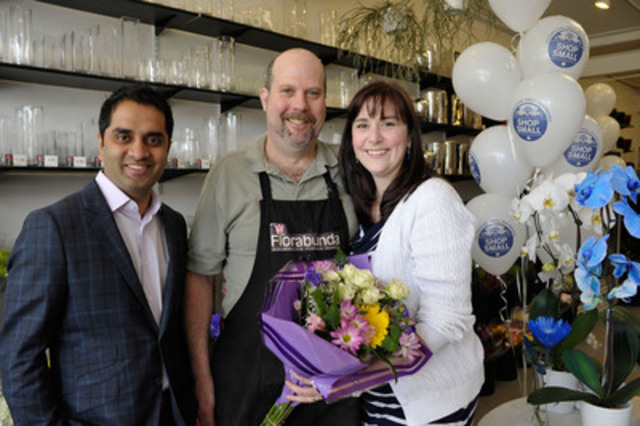 American Express Canada VP Merchant Marketing Abhi Rege, left, joins Marc and Kelly Staples, owners of Florabunda - Leslieville's Flower Market, to celebrate winning Toronto's Neighbourhood Gems Contest as part of the American Express Shop Small Program, Monday May 13, 2013. THE CANADIAN PRESS IMAGES/J.P. Moczulski (CNW Group/American Express)