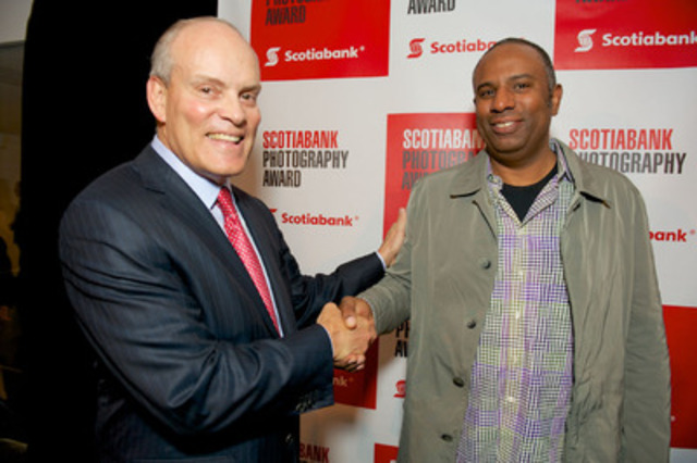 Scotiabank President Brian Porter (L) congratulates Stan Douglas, the winner of the 2013 Scotiabank Photography Award. As winner of the Award he receives a $50,000 cash prize, a book published and distributed worldwide by Steidl and a primary exhibition at the 2014 Scotiabank CONTACT Photography Festival. (CNW Group/Scotiabank)