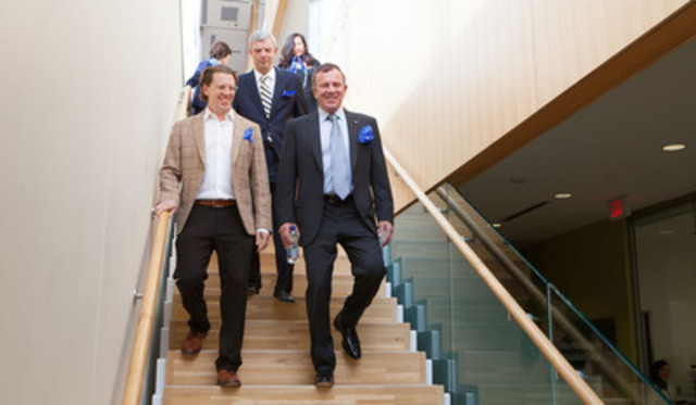 Peter Gilligan (bottom right) accompanied by his son Luke (left) arrives at St. Michael's Hospital to donate $30 million toward the building of a new patient care tower, along with hospital president Dr. Robert Howard. (CNW Group/St. Michael's Hospital)