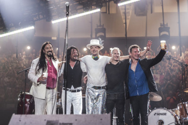 The Tragically Hip after the final show of their Man Machine Poem tour in Kingston. (CNW Group/Bell Media)