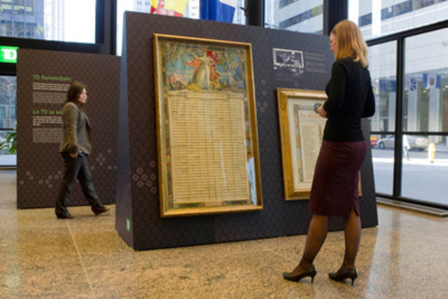 Archivist, Anne Spruin reviews a roll of honour incorporating a painting by Group of Seven artist J.E.H. MacDonald, commissioned by TD Bank Group (formerly Dominion Bank) to commemorate employees who served in the First World War. The piece is part of an exhibit honouring TD employees that served during the World Wars. The public display is at the TD Canada Trust branch (corner of King and Bay Streets) 8:00 a.m. to 8:00 p.m. through Friday, November 9th. (CNW Group/TD Bank Group)