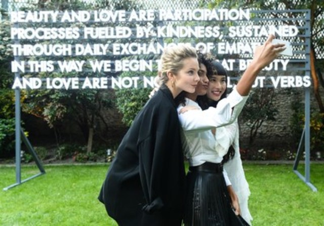 Faces of Shiseido's new campaign, Enikő Mihalik, Imman Hammam and Asia Chow pose in front of Robert Montgomery's work in Paris where Shiseido's renewed brand identity was first revealed in 2015. Robert Montgomery's pieces will be shown at Nuit Blanche in Toronto this year. (CNW Group/Shiseido)