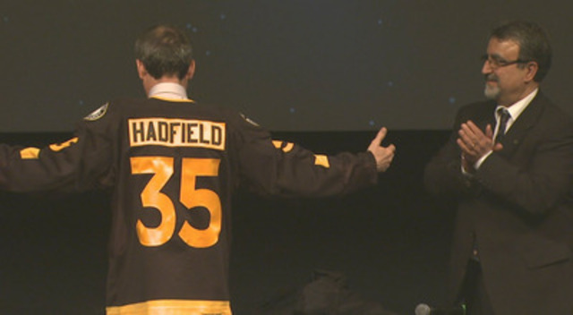 Following his first public lecture after being appointed a professor at the University of Waterloo, Professor Chris Hadfield was presented with a Waterloo Warriors hockey jersey that bears his name. (CNW Group/University of Waterloo)