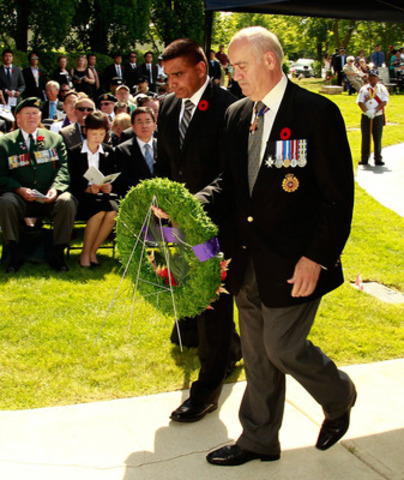 The Honourable Julian Fantino, Minister of Veterans Affairs, and Parliamentary Secretary Parm Gill lay a wreath to recognize the anniversary of the signing of the Korean Armistice Agreement and Korean War Veterans Day. (CNW Group/Veterans Affairs Canada)