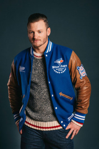 Blue Jays star Josh Donaldson in his hot-selling Roots Blue Jays Jacket made at the Roots factory in Toronto. (CNW Group/Roots Canada Ltd.)