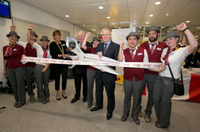 Air Canada rouge Manchester 6 - Renee Smith-Valade, Vice President Customer Experience, Air Canada rouge (fourth from left); Robert Atkinson, General Manager UK, Ireland and Northern Europe, Air Canada (fifth from left); Andrew Harrison, Managing Director, Manchester Airport (fourth from right); and Air Canada rouge crew inaugurate the seasonal Manchester-Toronto service with a ribbon-cutting ceremony at Manchester Airport on 27 June 2014 (CNW Group/Air Canada rouge)