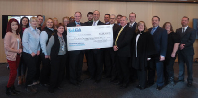 LCBO representatives celebrate the generosity of customers and staff who raised a record $1.2 million for SickKids Foundation, including President & CEO Ted Garrard (centre left), as part of the 2013 Giving Back In Our Community campaign. (CNW Group/LCBO)