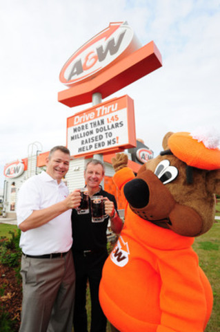 Cruisin' to End MS: On August 21, A&W raised $1.45 million during its 6th annual Cruisin' to End MS event to benefit the MS Society of Canada. On this day, $1 from every Teen Burger® sold was donated to help end MS. Yves Savoie, President and CEO, Multiple Sclerosis Society of Canada (left) and Paul Hollands, President and CEO, A&W Food Services of Canada Inc. (right) were joined by the Great A&W Root Bear® in Kitchener, Ont. Credit: A&W Food Services of Canada Inc. (CNW Group/A&W Food Services of Canada Inc.)