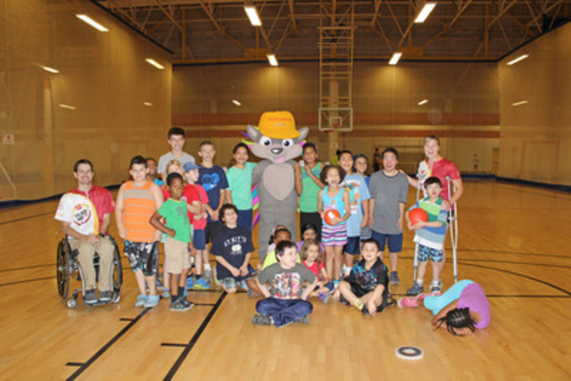 CIBC Team Next athlete, Cody Caldwell, and mentor, Stephanie Dixon, inspired kids at Variety Village on the one year countdown to the TORONTO 2015 Parapan Am Games with help from Mascot PACHI. (CNW Group/CIBC)