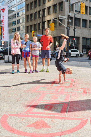 Canadian Tire encourages Canadians to get outside and play via #WannaPlay. Today, Toronto and Vancouver woke up to hopscotch installations in urban areas of the city and were invited to hop, skip, and jump on their way to work. (CNW Group/CANADIAN TIRE CORPORATION, LIMITED)