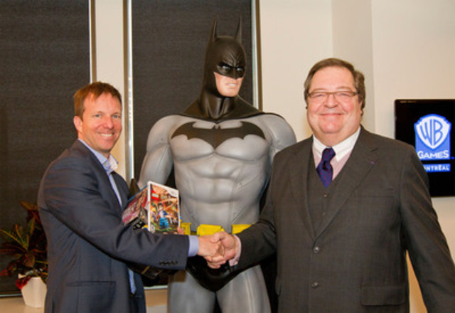 Mr. Martin Carrier, Vice-President and Studio Head, Warner Bros. Games Montreal, gave movies and video games to Mr. Guy Berthiaume, Chair and Chief Executive Officer, Bibliothèque et Archives nationales du Québec, to mark the launch of their partnership. (CNW Group/Warner Bros. Games Montreal)