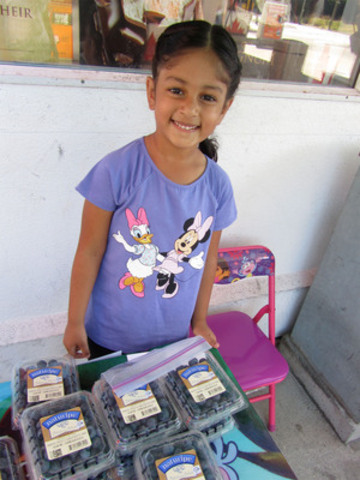 Five-year old Riyah Biln of Maple Ridge, B.C. sold blueberries to support World Vision Canada's Horn of Africa relief efforts. (CNW Group/World Vision Canada)