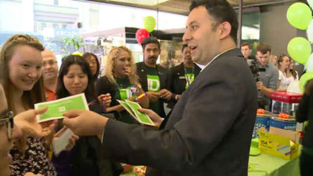 "B-roll: TD employees greet customers with a surprise thank-you appreciation event and hand out a green envelope containing $20 to each customer - a small gift to say ""Thank You."""