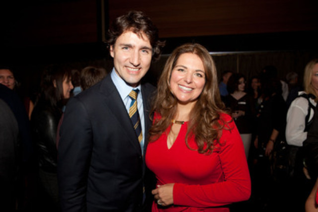 Federal Liberal leadership candidate Justin Trudeau, left, congratulates author Rikia Saddy at the Vancouver launch of her book We are Canada. Trudeau and Saddy share the view that Canadians are one. Image © Jaime Kowal (CNW Group/Justin Trudeau / Rikia Saddy)