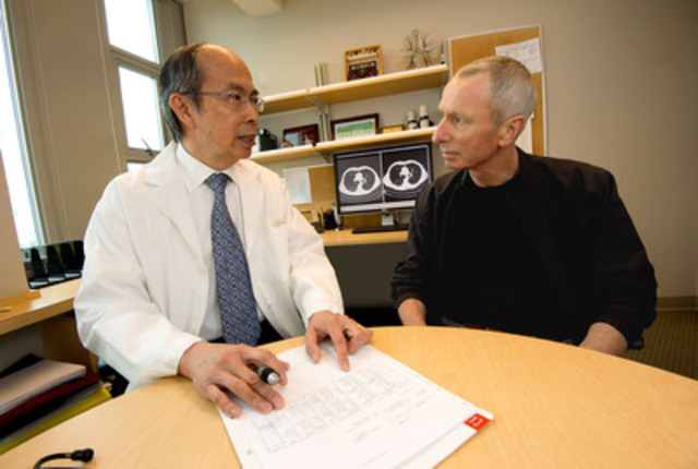Dr. Stephen Lam (BC Cancer Agency, Vancouver) , principal investigator of the Terry Fox Research Institute's Pan-Canadian Early Lung Cancer Detection Study , speaks with Vancouver-site study participant and resident Mr. Chris Douglas, 65, who had a cancerous nodule surgically removed in 2011 after it was detected on a CT scan (shown on screen in background) taken during the study. Photo credit: BC Cancer Agency.(CNW Group/Terry Fox Research Institute)