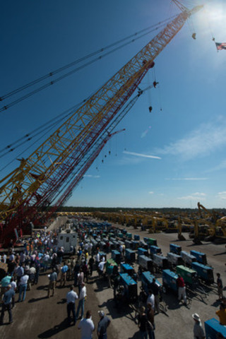 A crowd of bidders gathers around a selection of cranes on Day Three of the Ritchie Bros. Orlando, FL auction (Feb. 18 - 23, 2013) (CNW Group/Ritchie Bros. Auctioneers)