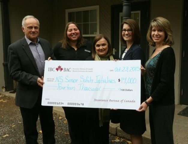 Amanda Dean, Vice-President, Atlantic, IBC gives a cheque to support seniors' programs (CNW Group/Insurance Bureau of Canada)