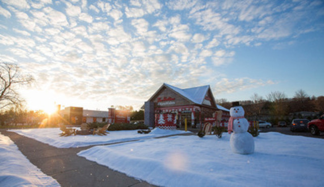 To kick off the Tim Hortons #WarmWishes campaign, a restaurant in Grimsby, Ontario has undergone an overnight transformation into a House of Warm Wishes. It's a picturesque snow-covered log cabin, and for one day, guests in restaurant can share their good deed requests on behalf of members of their community. Tim Hortons ambassadors will be busy all day fulfilling as many good deeds as possible - big and small. (CNW Group/Tim Hortons)