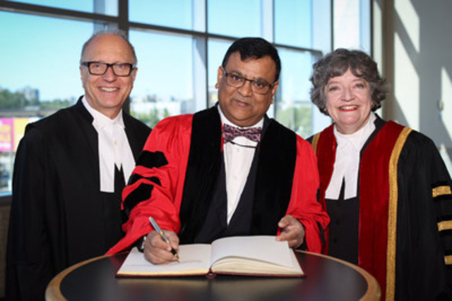 Legal humanitarian Mark M. Persaud (centre) received an Honorary LLD from the Law Society at the London Call to the Bar ceremony June 17. Here, he signs the LLD Register with Law Society CEO Robert G.W. Lapper. Q.C., and Law Society Treasurer Janet E. Minor. Persaud delivered the keynote address to the 113 new lawyers attending the ceremony. The Law Society awards honorary doctorates to distinguished people in recognition of outstanding achievements in the legal profession, the rule of law or the cause of justice. (CNW Group/The Law Society of Upper Canada)