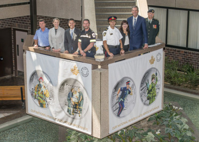 Royal Canadian Mint President Sandra Hanington, Winnipeg Mayor Brian Bowman, Mint Board of Directors member Bonnie Staples-Lyon and Manitoba Premier Brian Pallister join emergency first responders, at the Mint's Winnipeg facility, in unveiling collector coins celebrating Canada's national heroes (May 17, 2016) (CNW Group/Royal Canadian Mint)