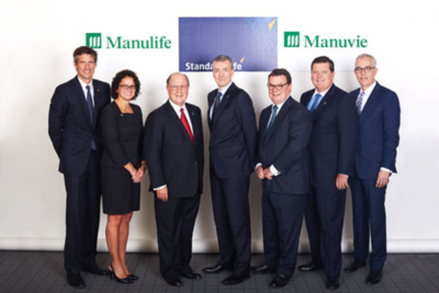 Senior executives from Manulife and Standard Life gather in Montreal for the announcement of Manulife's ...