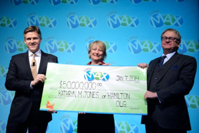 OLG's President and CEO Rod Phillips and OLG's Chair of the Board of Directors Philip Olsson present Hamilton resident Kathryn Jones with a cheque for $50,000,000 at the OLG Prize Centre Tuesday. Kathryn won the November 30, 2012 LOTTO MAX jackpot. (CNW Group/OLG Winners)