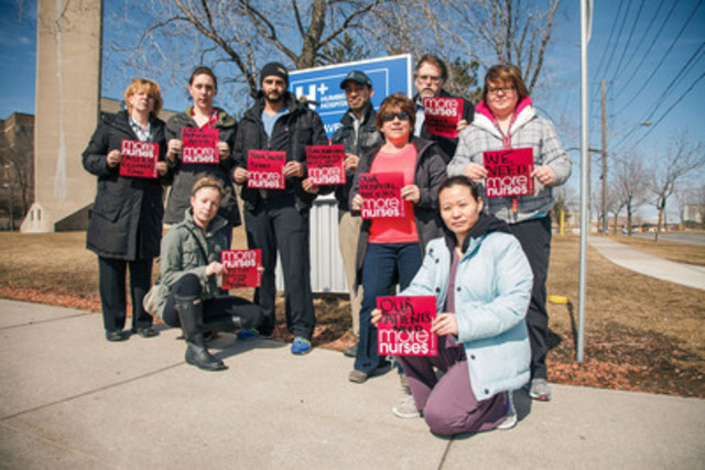 Registered nurses, members of the Ontario Nurses' Association (ONA), hold signs calling for more RNs to be hired in this April 8 photo at the Humber River Hospital Finch Street site in Toronto (Photo Credit: Gregory Bennett) (CNW Group/Ontario Nurses' Association)