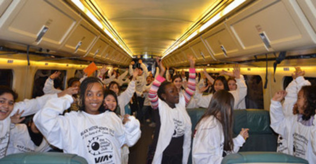 Some very excited members of the Toronto Children's Breakfast Club on board a VIA train headed for Ottawa on January 31, 2012, getting ready to mark Black History Month on Parliament Hill. (CNW Group/VIA RAIL CANADA INC.)