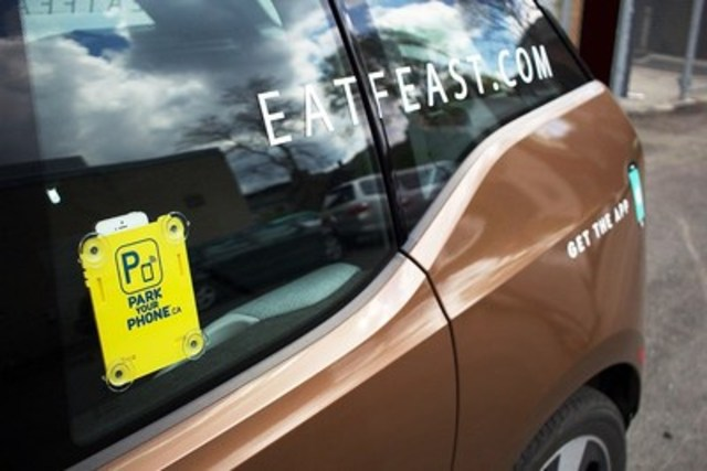 """FEAST, the Toronto based virtual restaurant that delivers chef inspired food to hungry urbanites in minutes has decided to """"park"""" their phones (when driving) in support of National Road Safety Week. Using PARK your PHONE, the Toronto based company that's out to make roads safer by helping change what people do with their phones BEFORE getting behind the wheel, FEAST has outfitted each of its vehicles with a PARK your PHONE window cradle to promote the fact that when their drivers are out making deliveries, they are not on their phones. www.parkyourphone.ca for more information. (CNW Group/PARKyourPHONE)"""