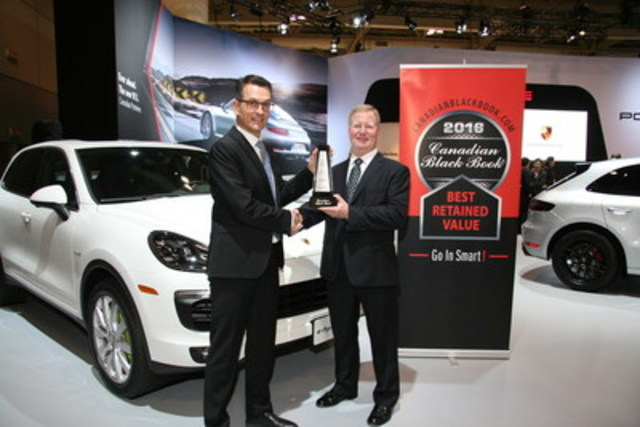 Brad Rome from Canadian Black Book presents to Alexander Pollich, President and CEO, Porsche Cars Canada, Ltd. with the 2016 Best Retained Value award for the Cayenne at the Canadian International Auto Show in Toronto on Thursday, February 11, 2016. (CNW Group/Porsche Cars Canada)