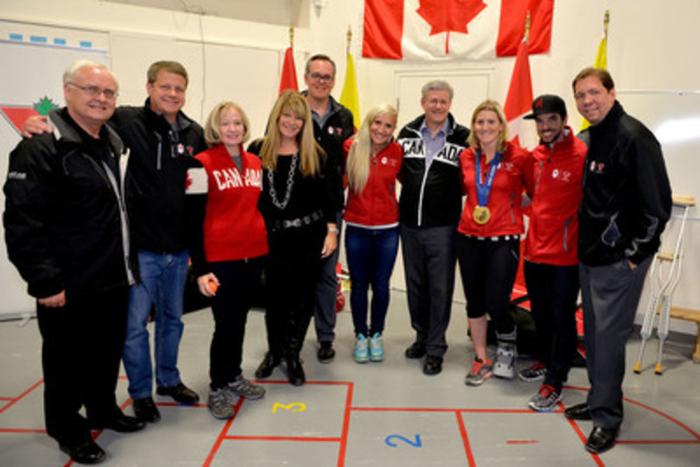 Today, Prime Minister Stephen Harper and Mrs. Laureen Harper joined Canadian Tire, Project North, and First Air as well as Olympic gold medalists Hayley Wickenheiser, Kaillie Humphries and Charles Hamelin to give Iqaluit kids 100 bags of hockey equipment to help get them onto the ice. (CNW Group/CANADIAN TIRE CORPORATION, LIMITED)