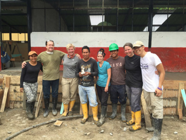Five Canadian teachers (L-R) Michel Bouthot, Marg Graff, Anick Champagne-Hickey, Anne-Marie Robinson-Sisk and Michael Fuchigami help build a school in Mondana, Ecuador alongside local community members, through the Staples Me to We Teacher Appreciation Contest. Staples Canada announced its $10,000 donation to Free The Children to help fund the school in April. (CNW Group/Staples Canada Inc.)
